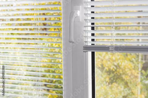 plastic window blinds horizontal fragment of the modern plastic window with white venetian blinds