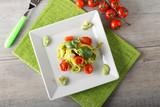 Pasta with zucchini pesto and cherry tomatoes - 198933366