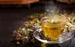 Leinwanddruck Bild - Cup of herbal tea with various herbs