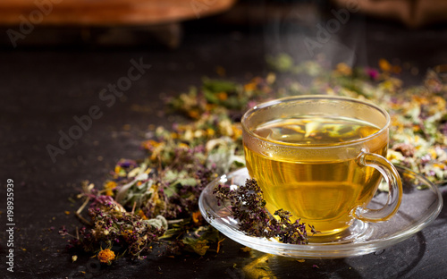 Cup of herbal tea with various herbs - 198935939