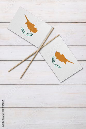 Fotobehang Cyprus Two Cyprus flags on a painted wood background