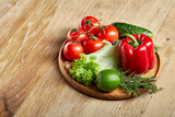Artistic still life of assorted fresh vegetables and herbs on rustic wooden background, top view, selective focus. - 198959547