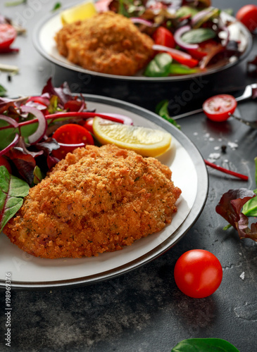 Foto op Plexiglas Kiev Breaded Chicken Kiev breast stuffed with butter, garlic and herbs served with vegetables in a plate.