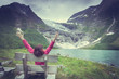 Tourist admiring Boyabreen Glacier in Norway