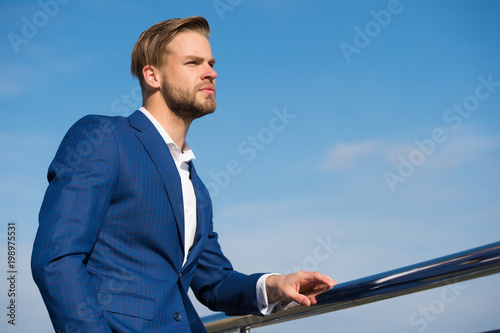 Manager on blue sky. Bearded man in business suit outdoor. Businessman on sunny day. Business fashion, style and dress code. Career, success and future concept, copy space