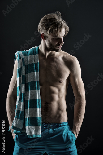 Foto op Plexiglas Spa Spa man with towel, hygiene after training. Spa model with with fit bare chest and belly muscles, health, vintage