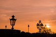 Sunset in Paris with silhouette of the luminaries