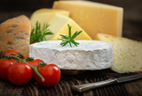 Cheeses with basil, rosemary and tomatoes. - 198984799