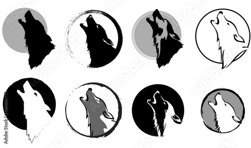 Fototapeta set of stylized images of a wolf glory wailing at the moon, black and white variants, vector illustration, isolated objects