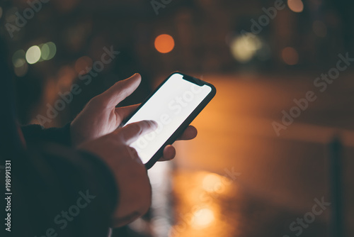 Close up image of man's hands with smartphone