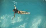 Woman swimming in the pool - 199010953