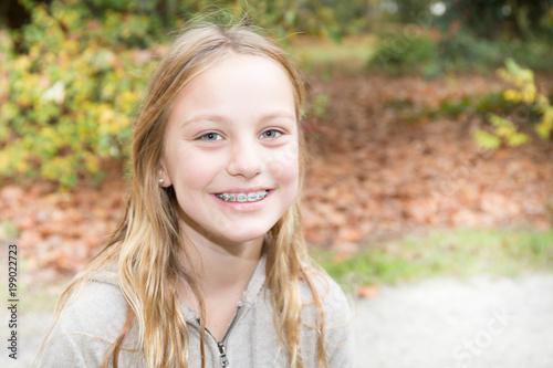 Foto Murales braces teeth teenager girl outdoor smiling beauty cute teen girls