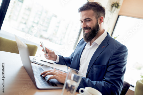 Business man working with documents and laptop - 199024932
