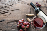 Wine glass, wine bottle and grapes on wooden background. Wine tasting. - 199028128