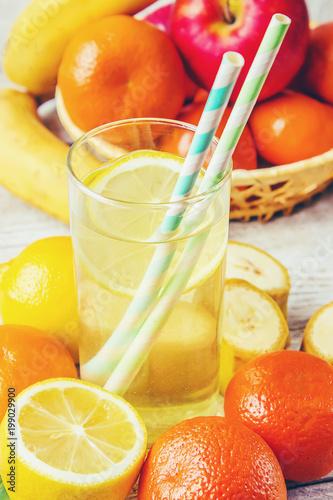 Fotobehang Sap Juice fresh lemon orange apple banana. Selective focus.