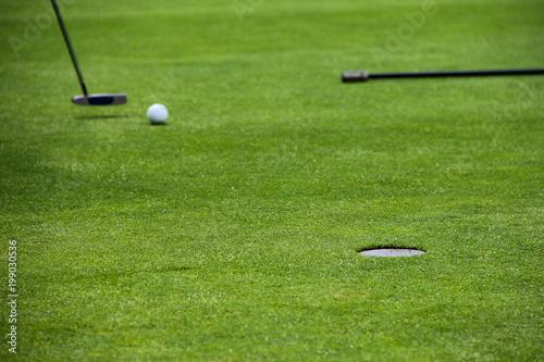 Golf putting on green - 199030536