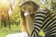 beautiful blonge young woman engoying warm day outdoor, reading, thinking, studying or working outdoor. Sunny day