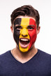 Face portrait of happy fan support Belgium national team with painted face isolated on white background