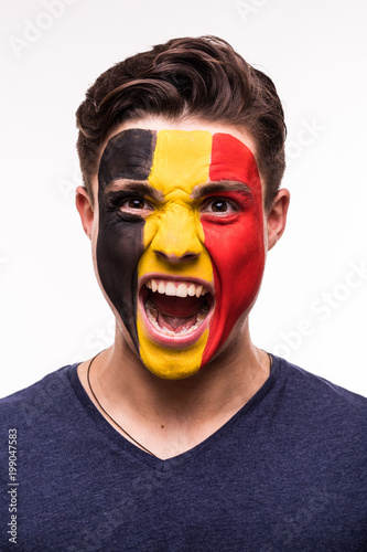 Plexiglas Voetbal Face portrait of happy fan support Belgium national team with painted face isolated on white background