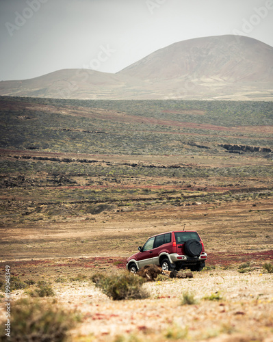 Leinwandbild Motiv off-road car on the road against  a mountain landscape