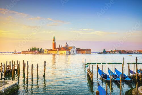 Fotobehang Venetie Venice lagoon, San Giorgio church, gondolas and poles. Italy