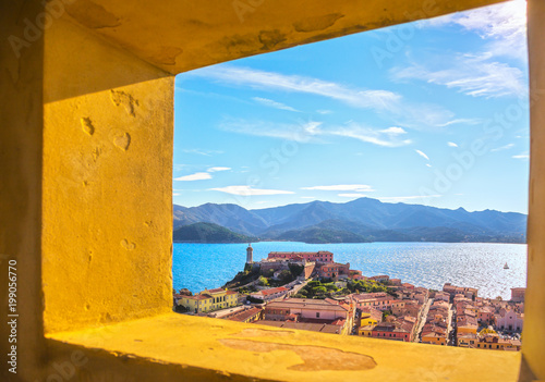 Elba island, Portoferraio aerial view from old window. Lighthouse and fort. Tuscany, Italy.