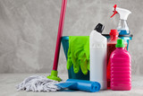 Cleaning supplies on grey background