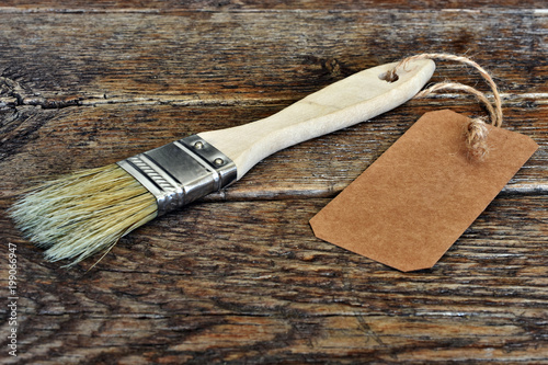 Old Wooden Paint Brush with Brown Label