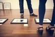 Photo frames on wooden floor