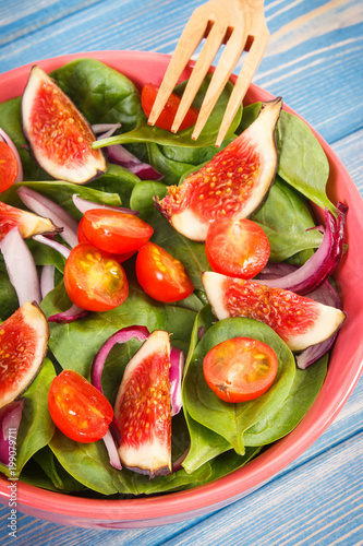 Fruit and vegetable salad with fork, healthy lifestyle and nutrition concept