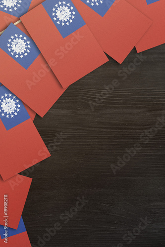 small Myanmar flags framing a wood texture background with copy space Poster