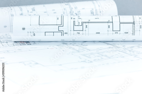 Fototapeta architectural project drawings and blueprints rolls on desk as construction background