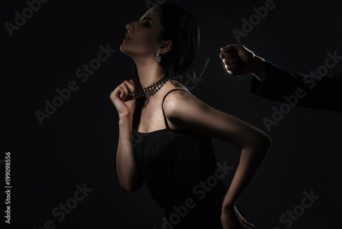 Male hand holds a sensual woman in collar. dominance concept - 199098556