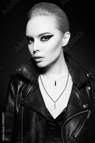 Fotobehang womenART Woman with bright makeup in leather jacket