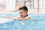 Young boy in a hot tub having fun, relaxing.