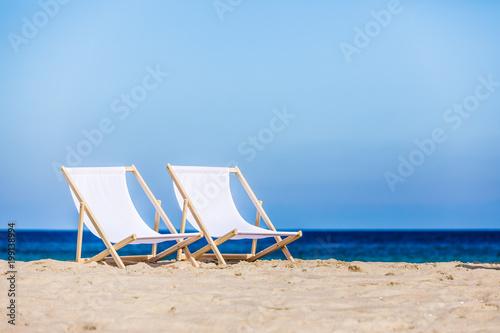 Foto Murales Deck chairs on beach