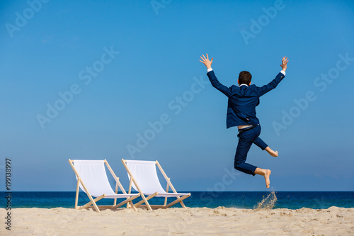 Fototapeta Man relaxing on beach