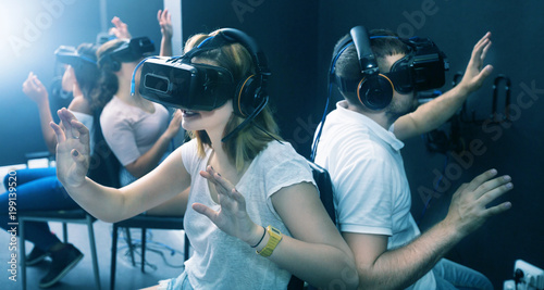 People having fun with vr headset goggles
