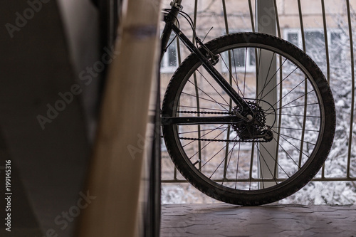 Foto op Plexiglas Fiets Bike standing in front of a window in a corridor