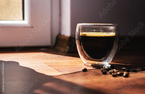 A cup of aromatic coffee in the morning sun.