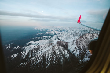 Mountains view through window of aircraft
