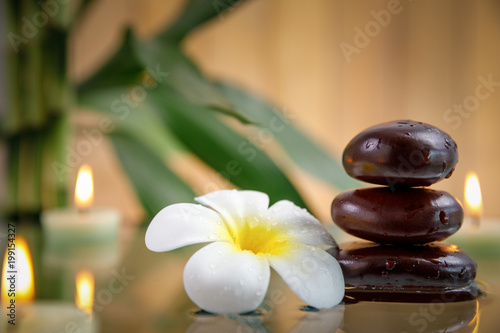 Foto op Canvas Zen spa concept with candle, stone, flower and bamboo, relaxation
