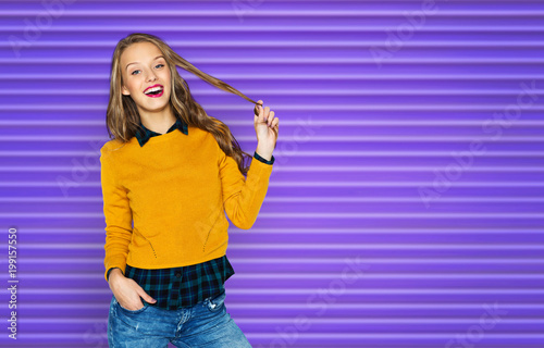 Foto op Plexiglas Kapsalon people, style, hairstyle and fashion concept - happy young woman or teen girl in casual clothes holding her hair strand