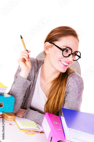 Woman sitting at desk in office working