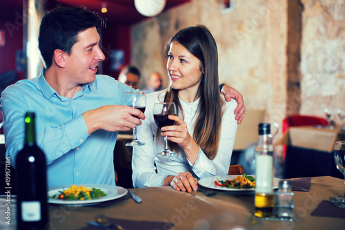 Romantic couple dinning at restaurant Poster