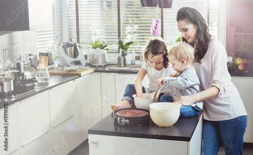 Fotobehang Artist KB Pretty mother making cake with her beloved children