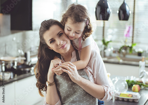 Fotobehang Konrad B. Portrait of a cute daughter hugging her mother