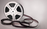 Old motion picture film reel on brown background - 199188581