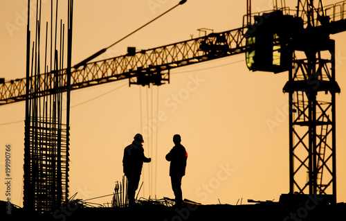 Engineer and worker at building site