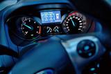 Car dashboard and steering wheel inside of car.